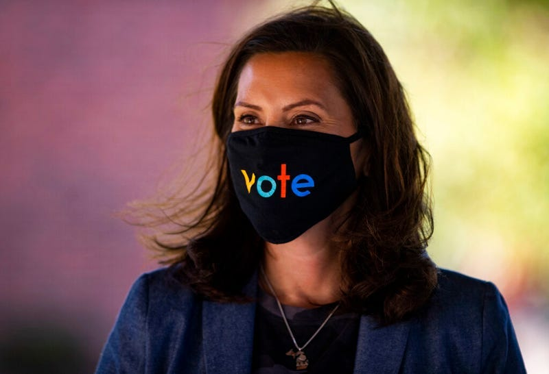 """Michigan Gov. Gretchen Whitmer wears a mask with the word """"vote"""" displayed on the front during a roundtable discussion on healthcare, Wednesday Oct. 7, 2020, in Kalamazoo, Mich. P"""