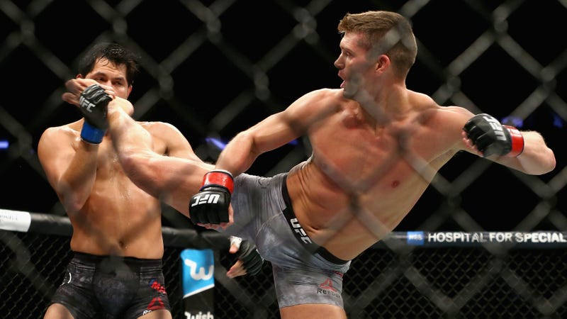 Stephen Thompson lands a kick to the face of Jorge Masvidal during a UFC fight in 2017.