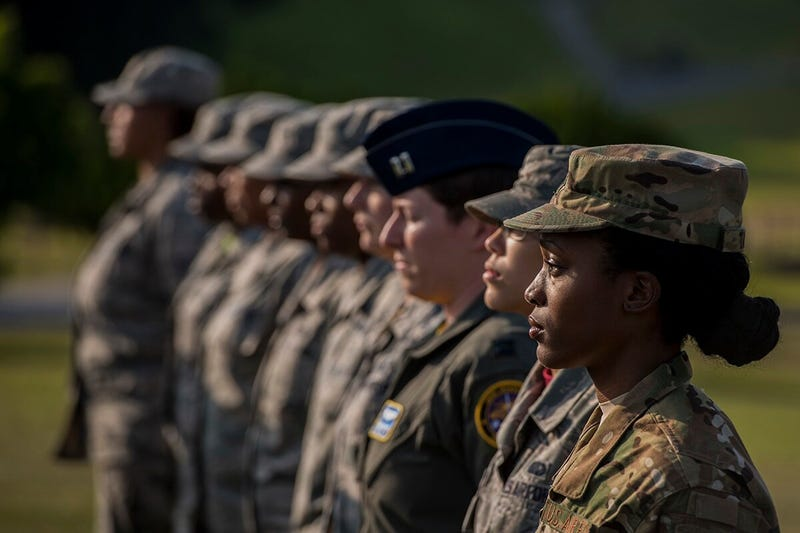 Airmen stand at attention during a retreat ceremony March 30, 2018, on Kadena Air Base, Japan. An all-female formation was coordinated in honor of Women's History Month, which brings attention to the accomplishments and achievements of women throughout history.