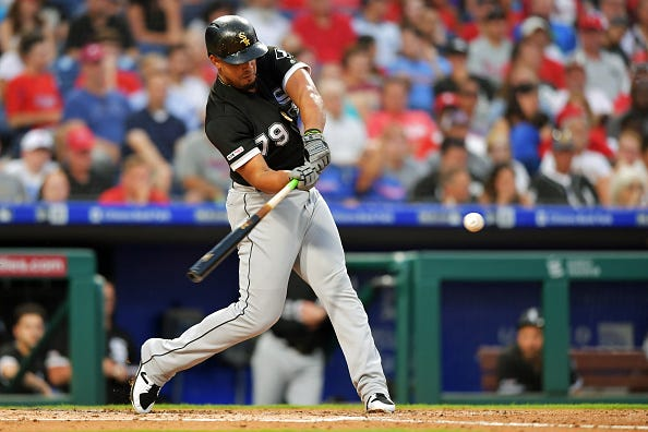 White Sox 1B Jose Abreu swings at a pitch against the Phillies.