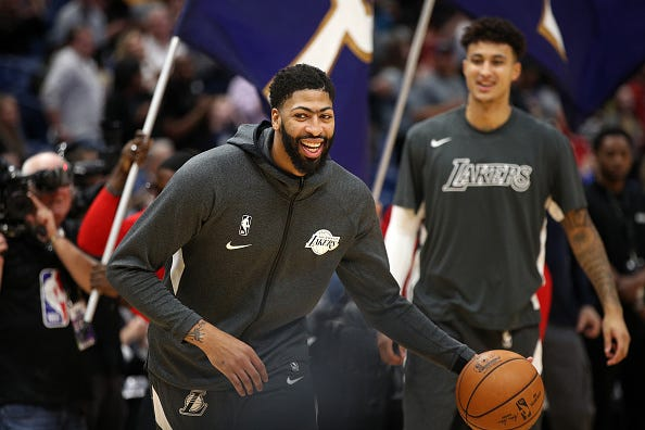Anthony Davis laughs during warmups with Lakers.