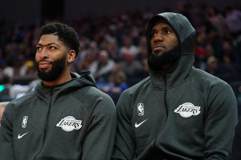 Anthony Davis and LeBron James prepare for a preseason game with Lakers.