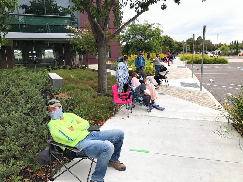 Long line forms for free rapid coronavirus tests in Alameda