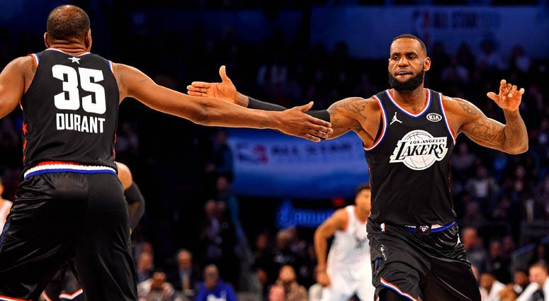 Team LeBron forward LeBron James reacts with teammate Kevin Durant (35) during the NBA All-Star Game at the Spectrum Center in Charlotte, North Carolina.