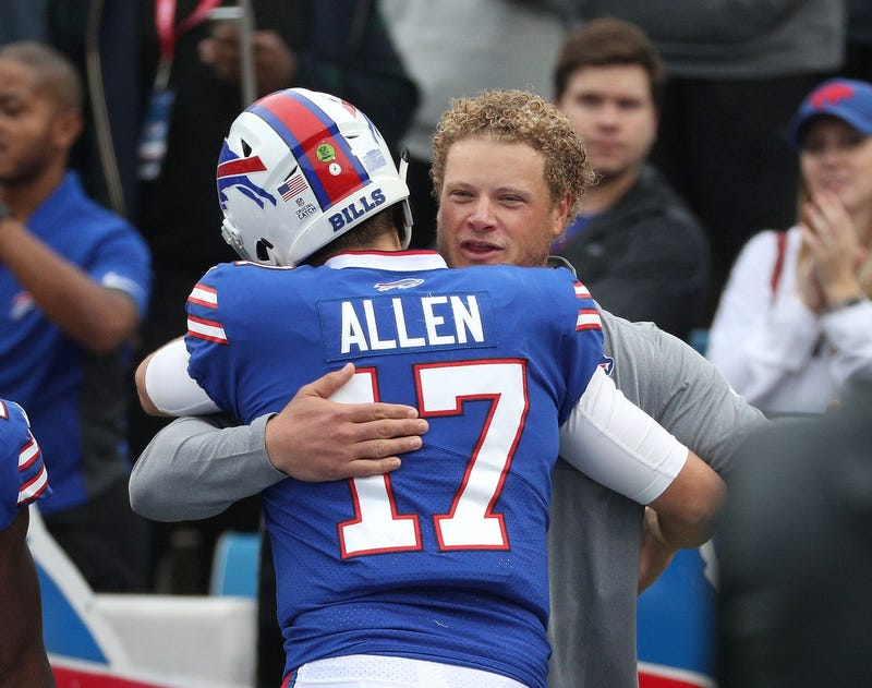 Former Bills center Eric Wood stopped on the field and visit with players including quarterback Josh Allen at a game in the past.