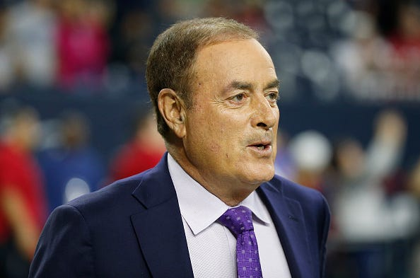 NBC's Al Michaels roams the sideline prior to an NFL game.