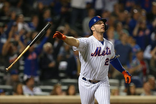 Pete Alonso flips his bat after belting a home run.
