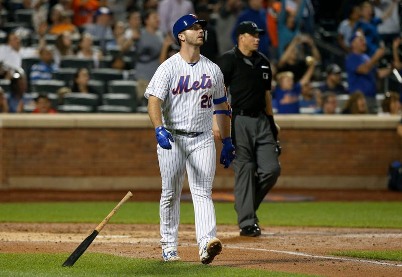 Pete Alonso struts down first base after belting a home run.