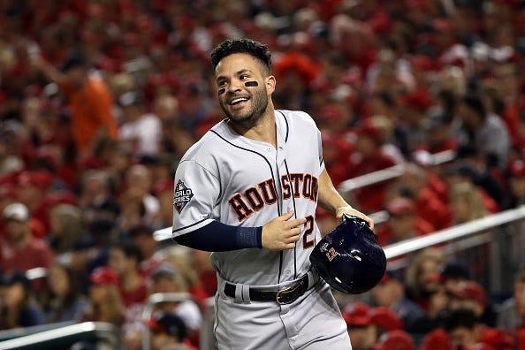 Jose Altuve celebrates scoring a run in the World Series
