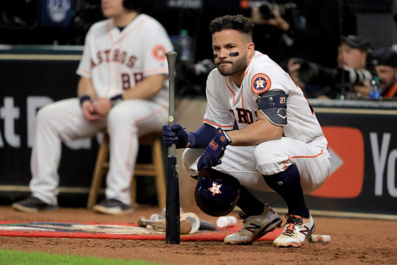 Astros 2B Jose Altuve watches from the on deck circle.