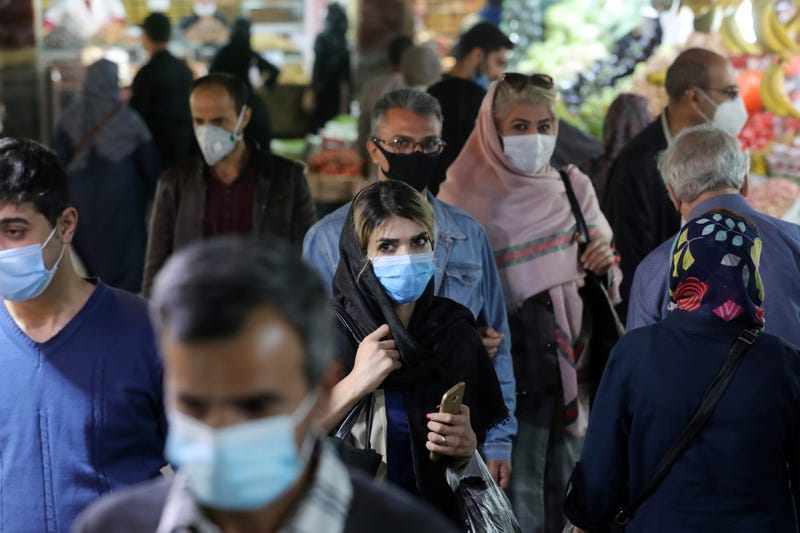 Virus Outbreak Iran Mixed Signals