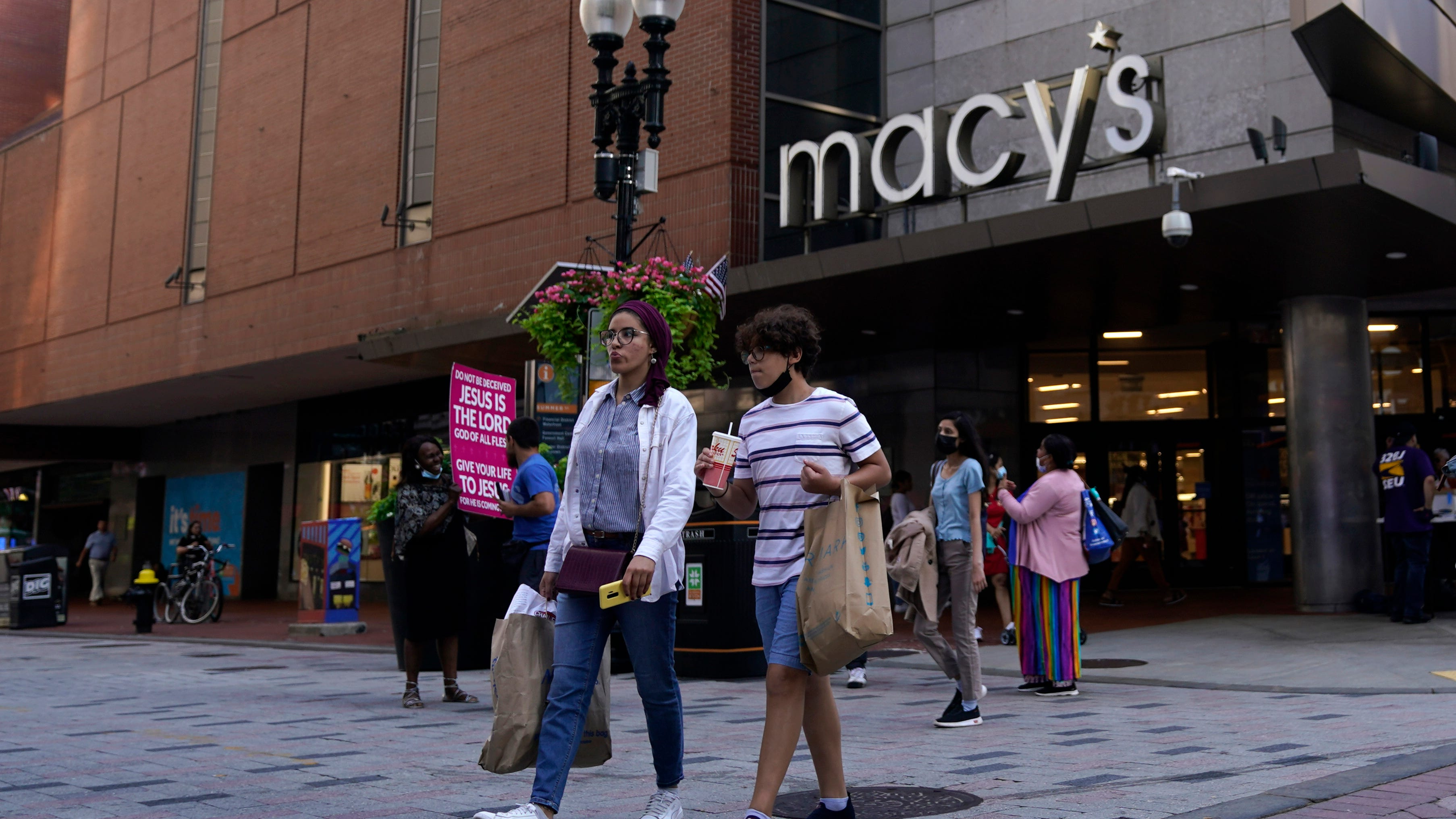 Americans spent less in July as COVID-19 cases surged