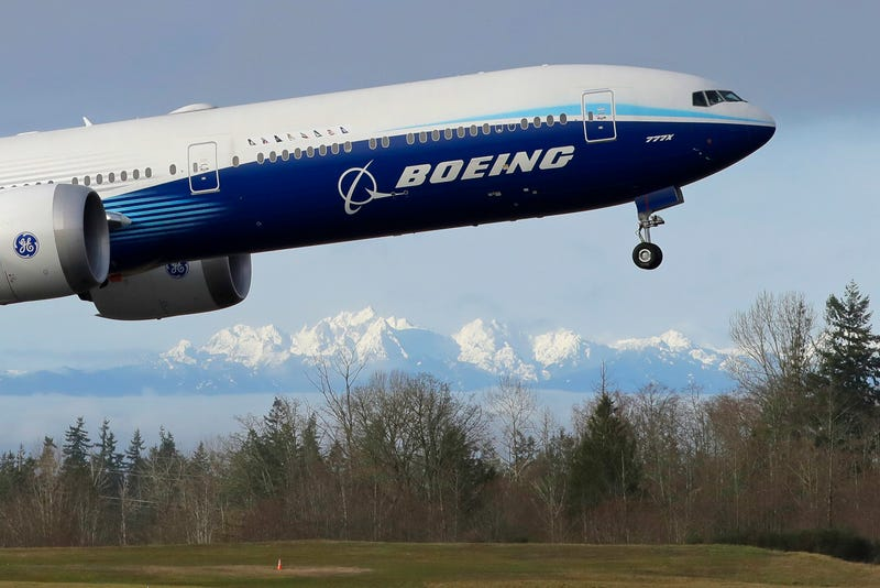 Earns Boeing
