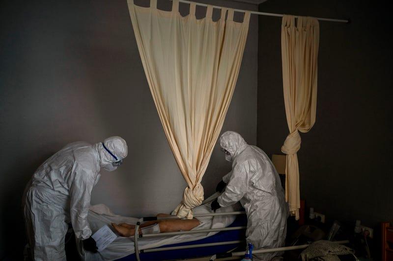 Virus Outbreak Spain's Body Collectors