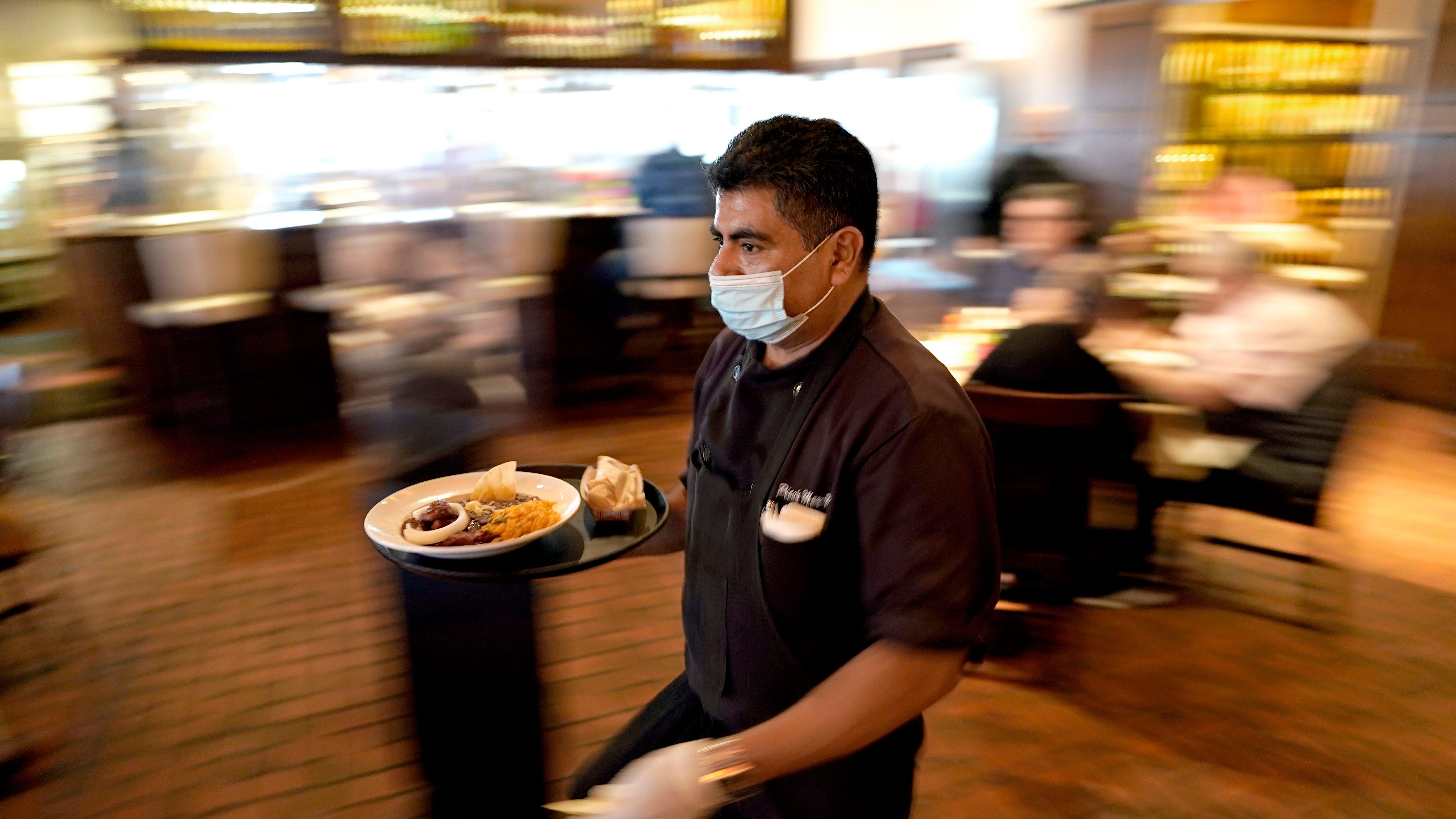 Half of US workers favor employee shot mandate: AP-NORC poll