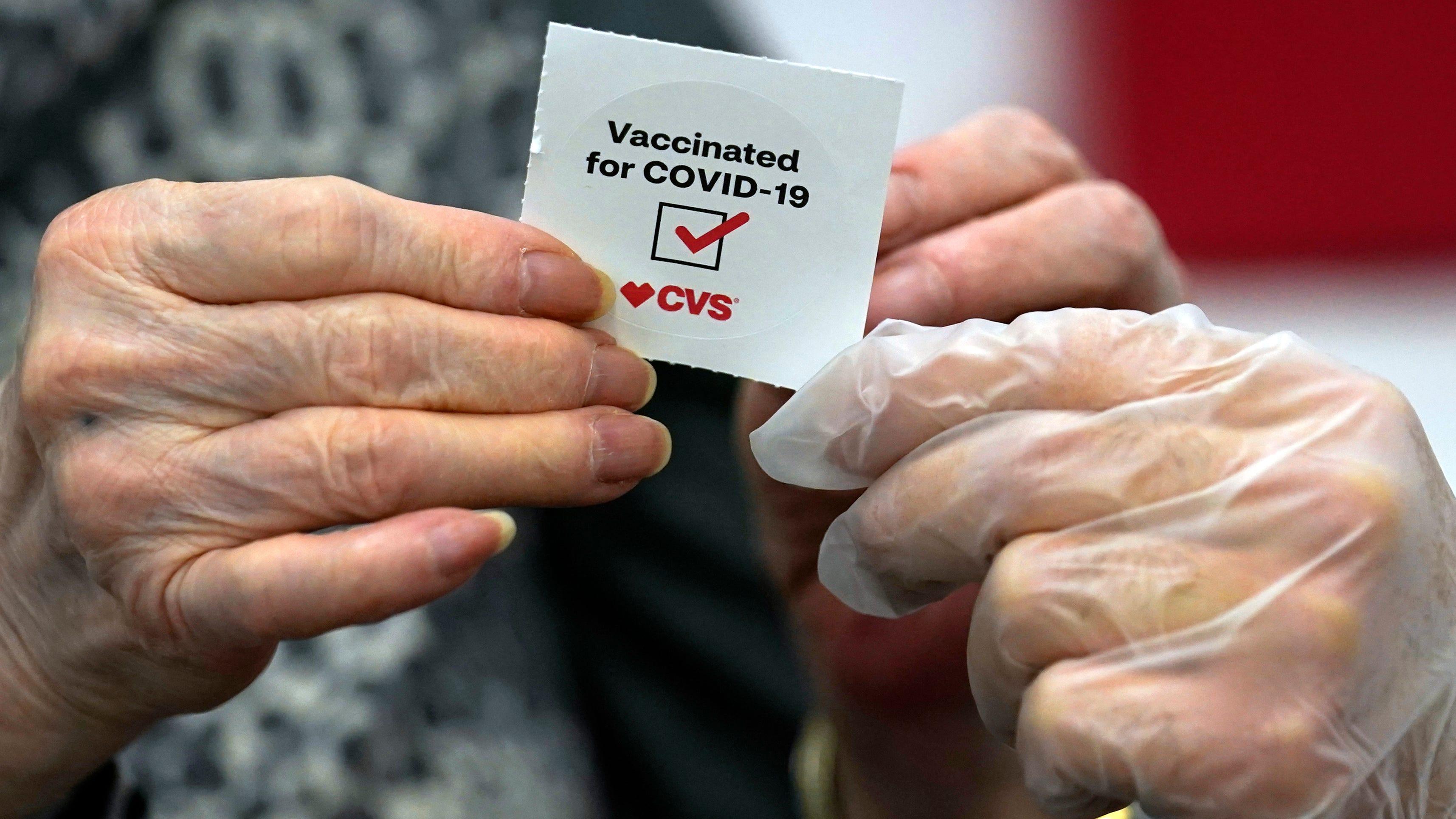 From CVS to Goldman Sachs, FDA move prompts vaccine mandates