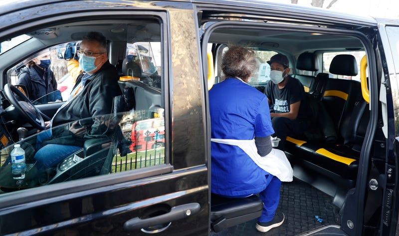 Virus Outbreak Britain Vaxi Taxi