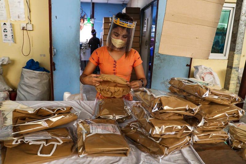 Virus Outbreak Myanmar Asia Garment Workers
