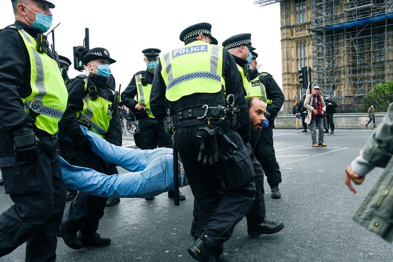 APTOPIX Virus Outbreak Britain Protest
