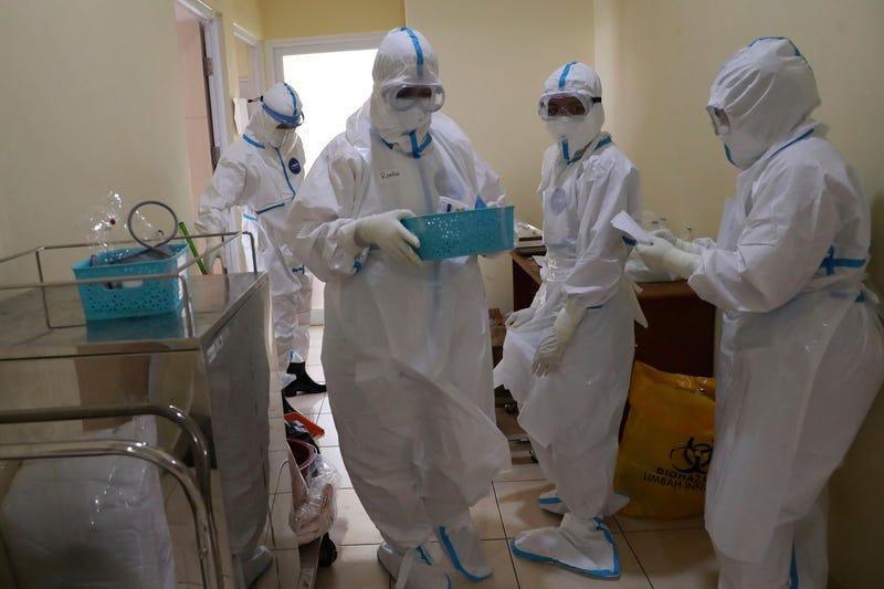 Virus Outbreak Indonesia Doctors