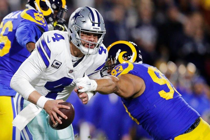 Dallas Cowboys quarterback Dak Prescott breaks away from Los Angeles Rams