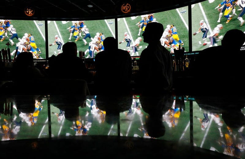People watch Super Bowl LIII at the Westgate Superbook sports book, Sunday, Feb. 3, 2019, in Las Vegas.