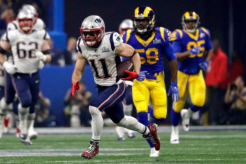 New England Patriots' Julian Edelman (11) runs the ball ahead of Los Angeles Rams' Cory Littleton (58) during the second half of the NFL Super Bowl 53 football game Sunday, Feb. 3, 2019, in Atlanta.