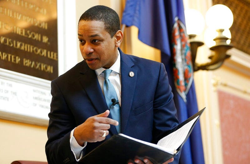 Virginia Lt. Gov Justin Fairfax looks over a briefing book prior to the start of the senate session at the Capitol in Richmond, Va., Thursday, Feb. 7, 2019