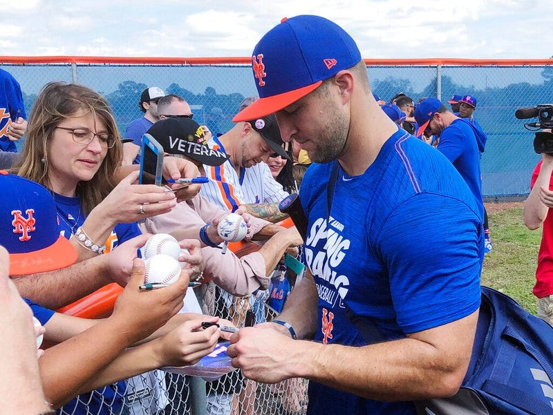 New York Mets' Tim Tebow signs autographs at spring training baseball practice Saturday, Feb. 16, 2019, in Port St. Lucie, Fla