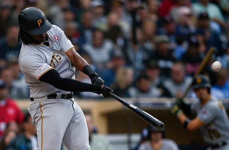 Pittsburgh Pirates' Josh Bell hits a three-run home run off a pitch by San Diego Padres' Nick Margevicius during the third inning of a baseball game in San Diego, Saturday, May 18, 2019.