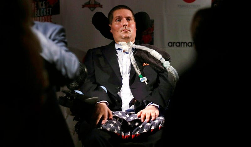 Pete Frates, who is stricken with amyotrophic lateral sclerosis, or ALS, listens to a guest at Fenway Park in Boston