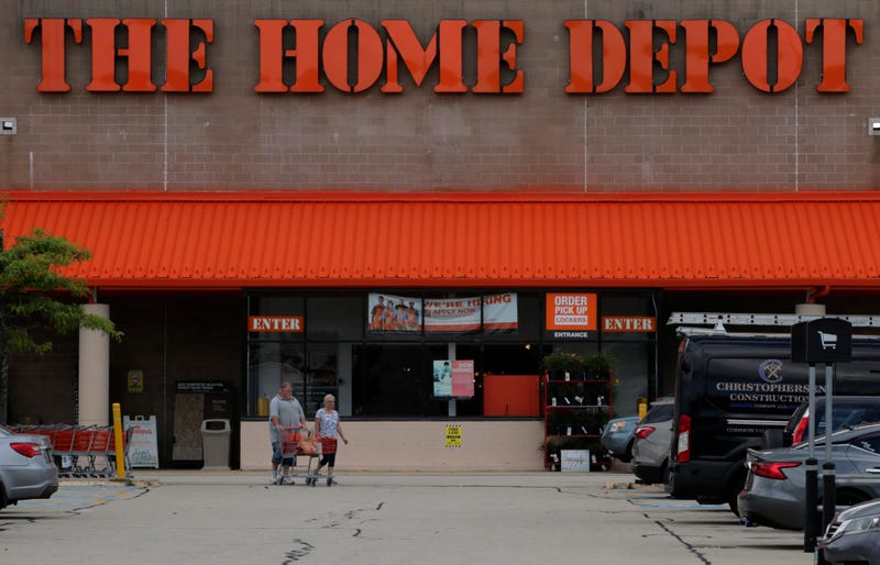 Shoppers leave the Home Depot store in Manchester, N.H., Thursday, Aug. 15, 2019.