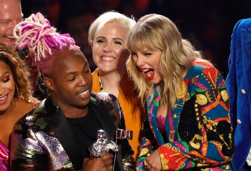 """Taylor Swift, right, accepts the video for good award for """"YouNeed to Calm Down"""" at the MTV Video Music Awards at the Prudential Center on Monday, Aug. 26, 2019, in Newark, N.J."""