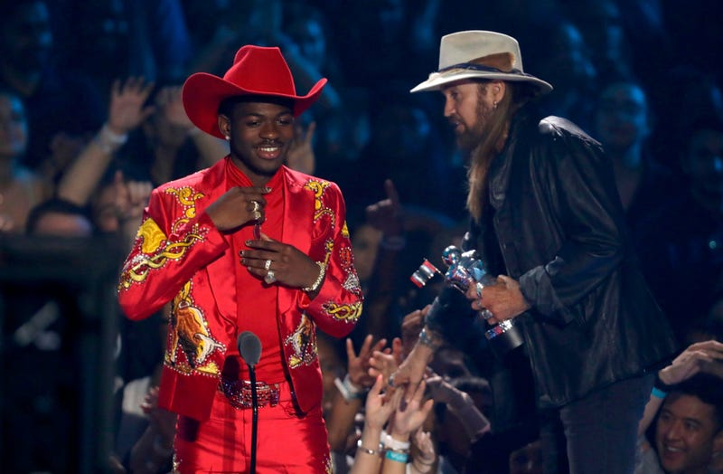 """Lil Nas X, left, and Billy Ray Cyrus accept the song of the year award for """"Old Town Road"""" at the MTV Video Music Awards at the Prudential Center on Monday, Aug. 26, 2019, in Newark, N.J."""