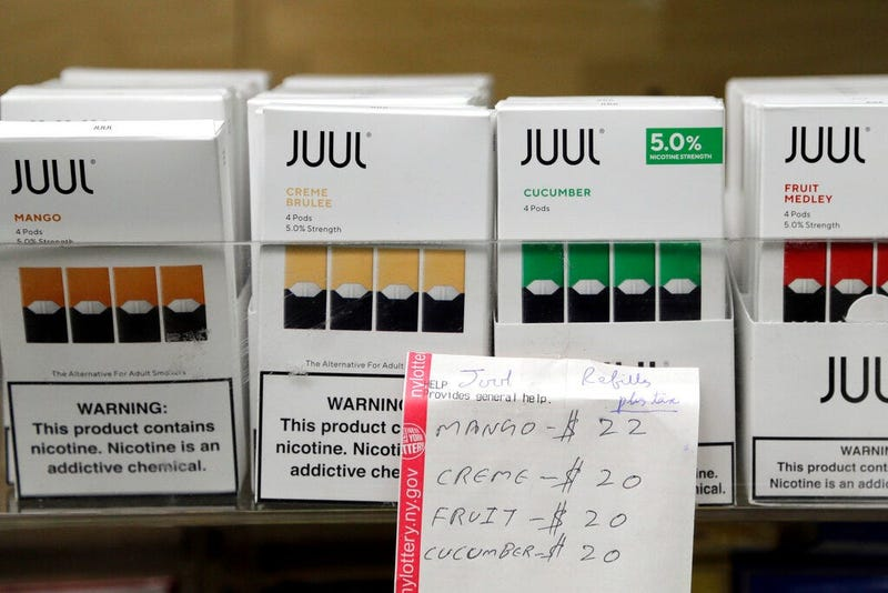 Juul products are displayed at a smoke shop in New York. On Thursday, Oct. 17, 2019, the company announced it will voluntarily stop selling its fruit and dessert-flavored vaping pods.