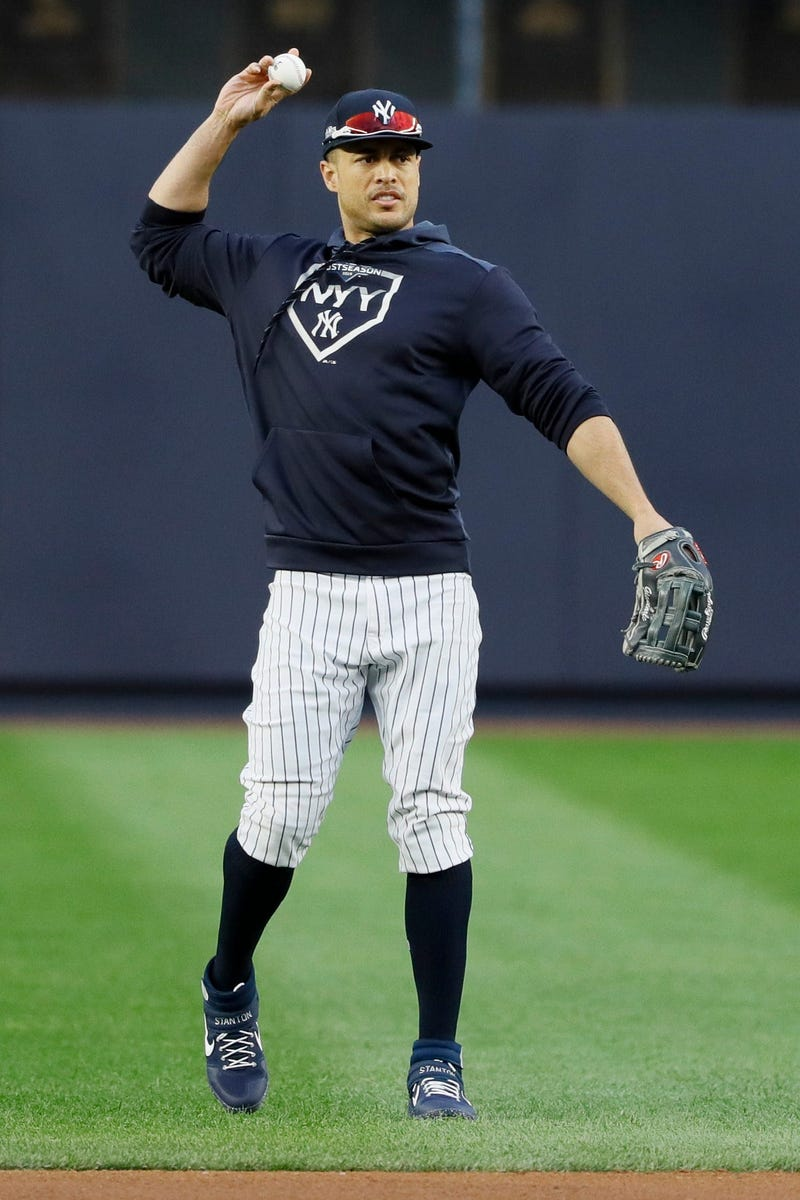 New York Yankees left fielder Giancarlo Stanton warms up during batting practice before Game 4 of baseball's American League Championship Series against the Houston Astros Thursday, Oct. 17, 2019, in New York.