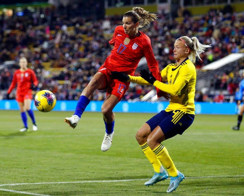 United States forward Tobin Heath, left, passes the ball in front of Sweden defender Hanna Glas during the first half of a women's international friendly soccer match in Columbus, Ohio, Thursday, Nov. 7, 2019.