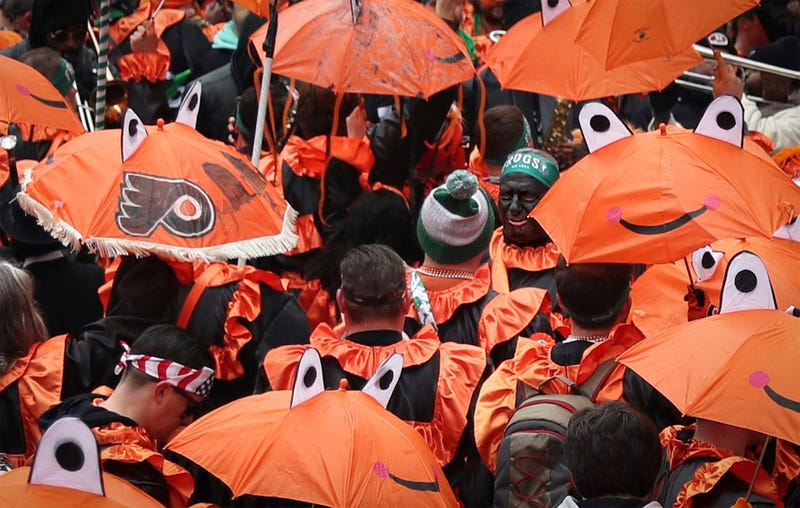 Members of the Froggy Carr club march during the Mummers Parade.