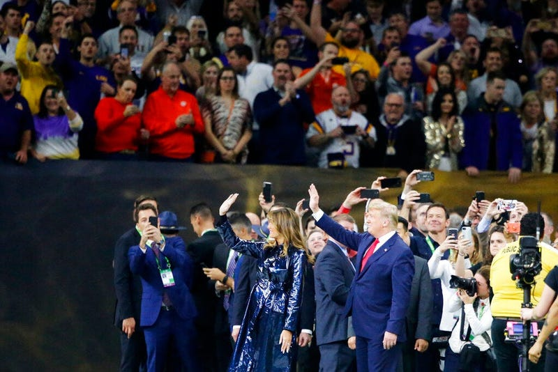 President Donald Trump and first lady Melania Trump arrive for the College Football Playoff National Championship game between LSU and Clemson, Monday, Jan. 13, 2020, in New Orleans.
