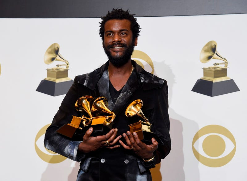Gary Clark Jr. poses in the press room with the awards for best rock song, best rock performance and best contemporary blues album at the 62nd annual Grammy Awards at the Staples Center on Sunday, Jan. 26, 2020, in Los Angeles.