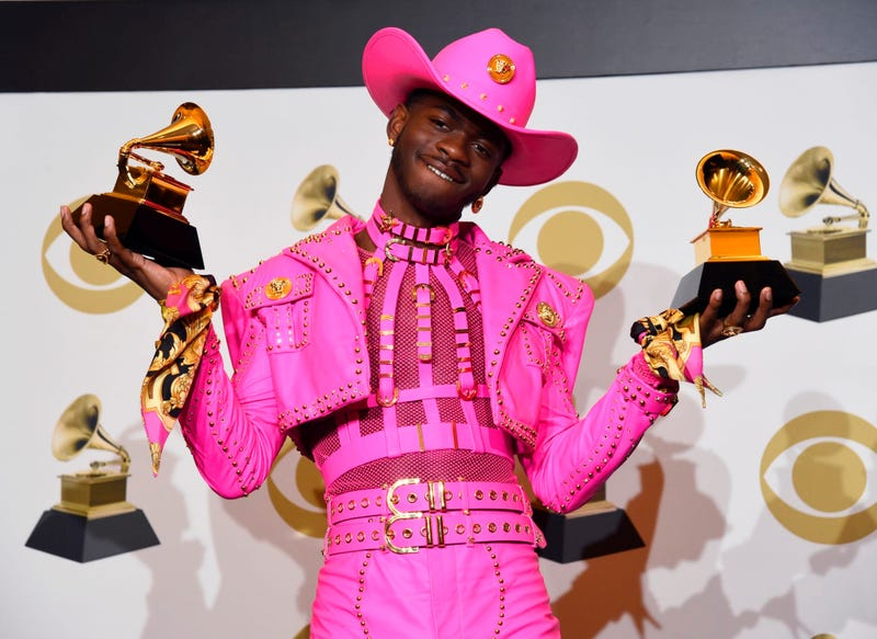 Lil Nas X poses in the press room with the awards for best music video and best pop duo/group performance at the 62nd annual Grammy Awards at the Staples Center on Sunday, Jan. 26, 2020, in Los Angeles.