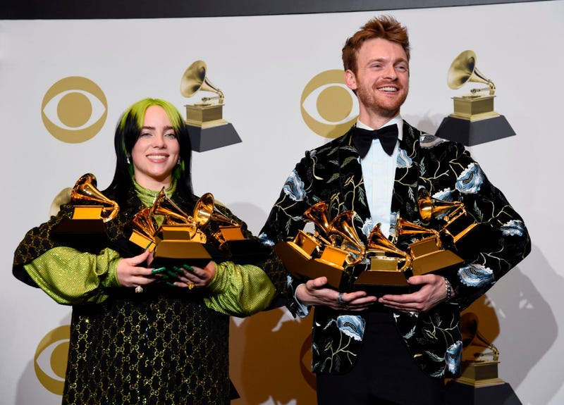 From left: Billie Eilish and Finneas O'Connell pose in the press room with the awards for best album, best engineered album, best pop vocal album, best song, best record, best new artist and best producer, non-classical, at the 62nd annual Grammy Awards.