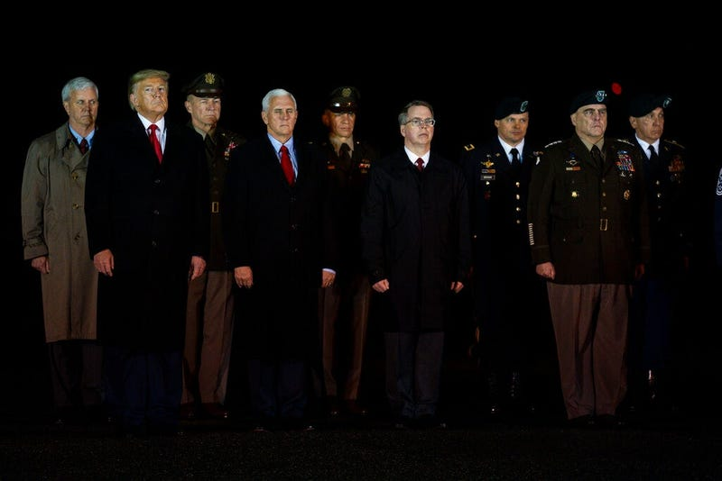 President Donald Trump and Vice President Mike Pence watches as a U.S. Army carry team salutes the transfer case's containing the remains of Sgt. 1st Class Javier Gutierrez, of San Antonio, Texasa and Sgt. 1st Class Antonio Rodriguez