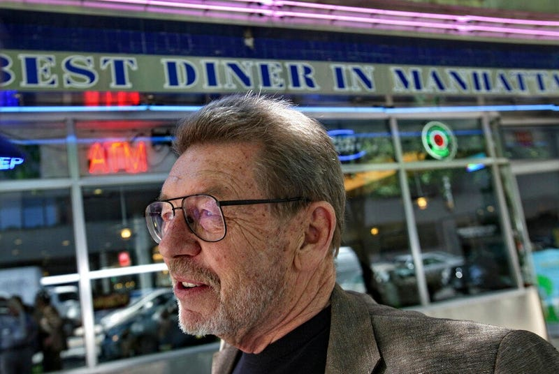 Pete Hamill responds during an interview at the Skylight Diner in New York. The longtime New York City newspaper columnist and author has died. (AP)
