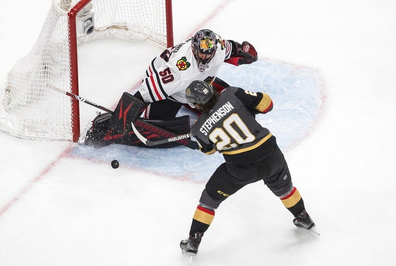Vegas Golden Knights' Chandler Stephenson (20) is stopped by Chicago Blackhawks goalie Corey Crawford (50) during the second period in Game 5 of an NHL hockey first-round playoff series, Tuesday, Aug. 18, 2020, in Edmonton, Alberta
