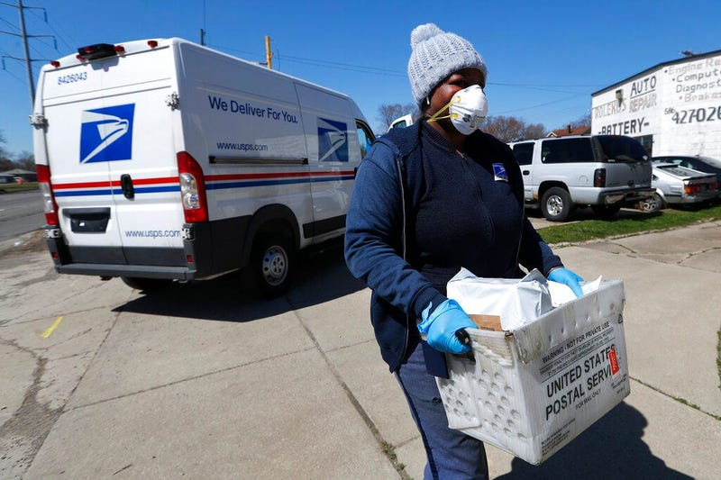 United States Postal Service worker makes a delivery