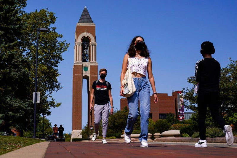 Masked students walk through the campus of Ball State University in Muncie, Indiana (AP)