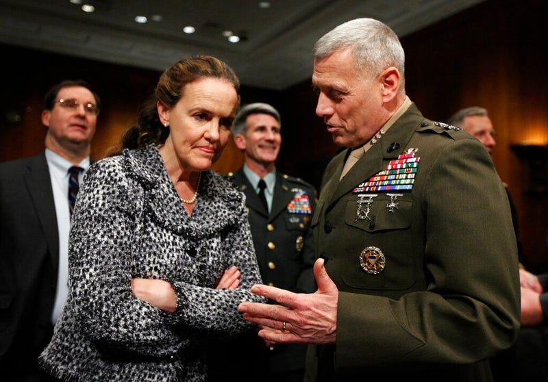 In this Feb. 22, 2010, file photo then-Defense Undersecretary for Policy Michele Flournoy, left, talks with Marines Lt. Gen. John Paxton