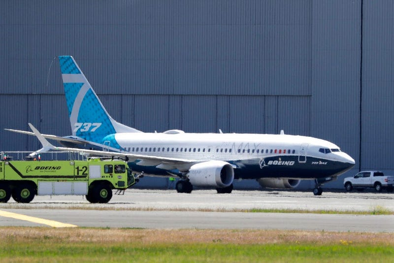 In this Monday, June 29, 2020, file photo, A Boeing 737 MAX jet taxis after landing at Boeing Field following a test flight in Seattle.