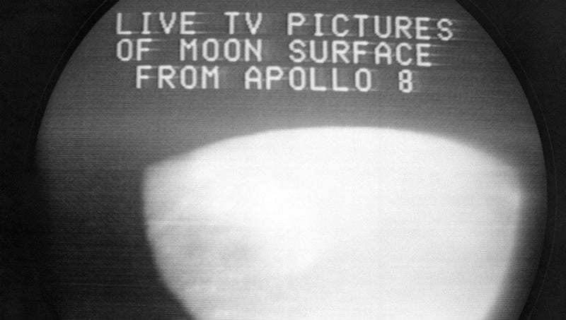 This Dec. 24, 1968, file photo shows a television screen with a view of the moon transmitted by the Apollo 8 astronauts as it orbited.